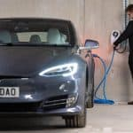 man-charging-car-with-eo-universal-ev-7kw